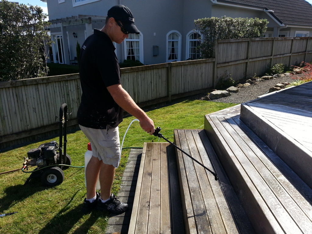 Franchise member cleaning deck