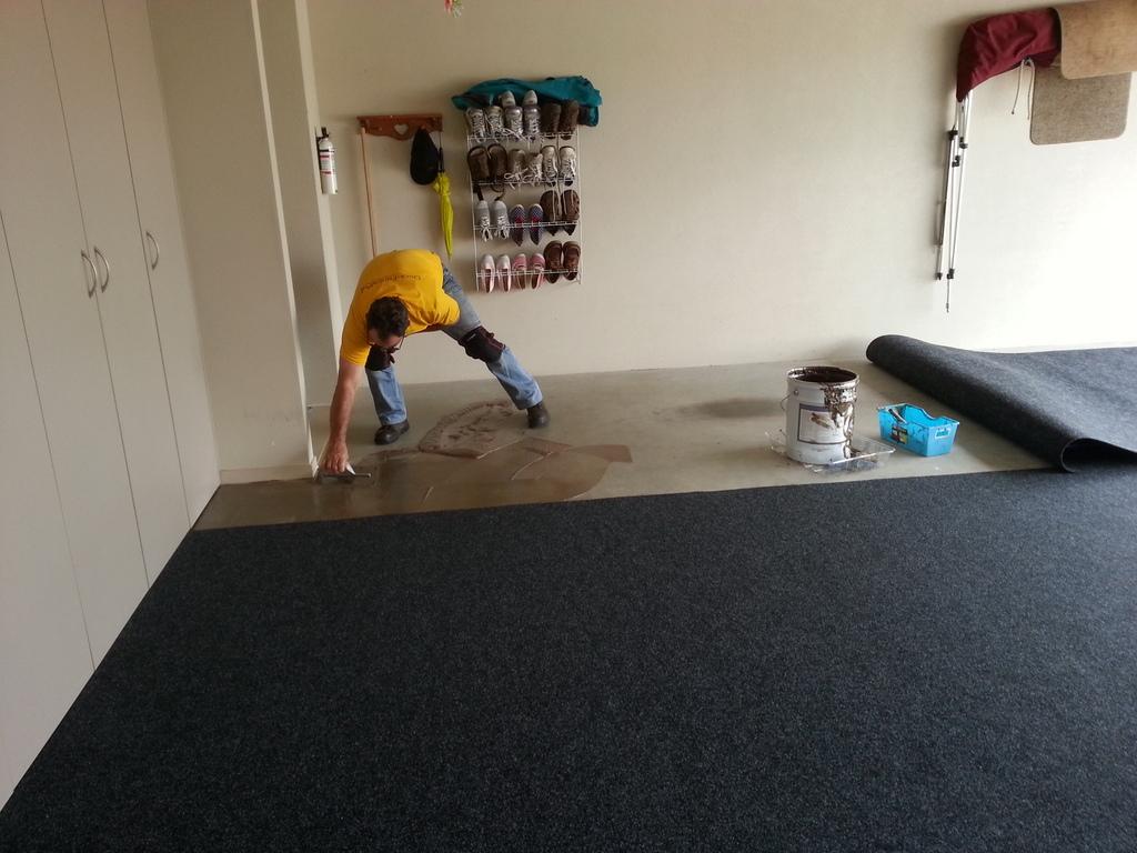 Franchise member installing garage carpet