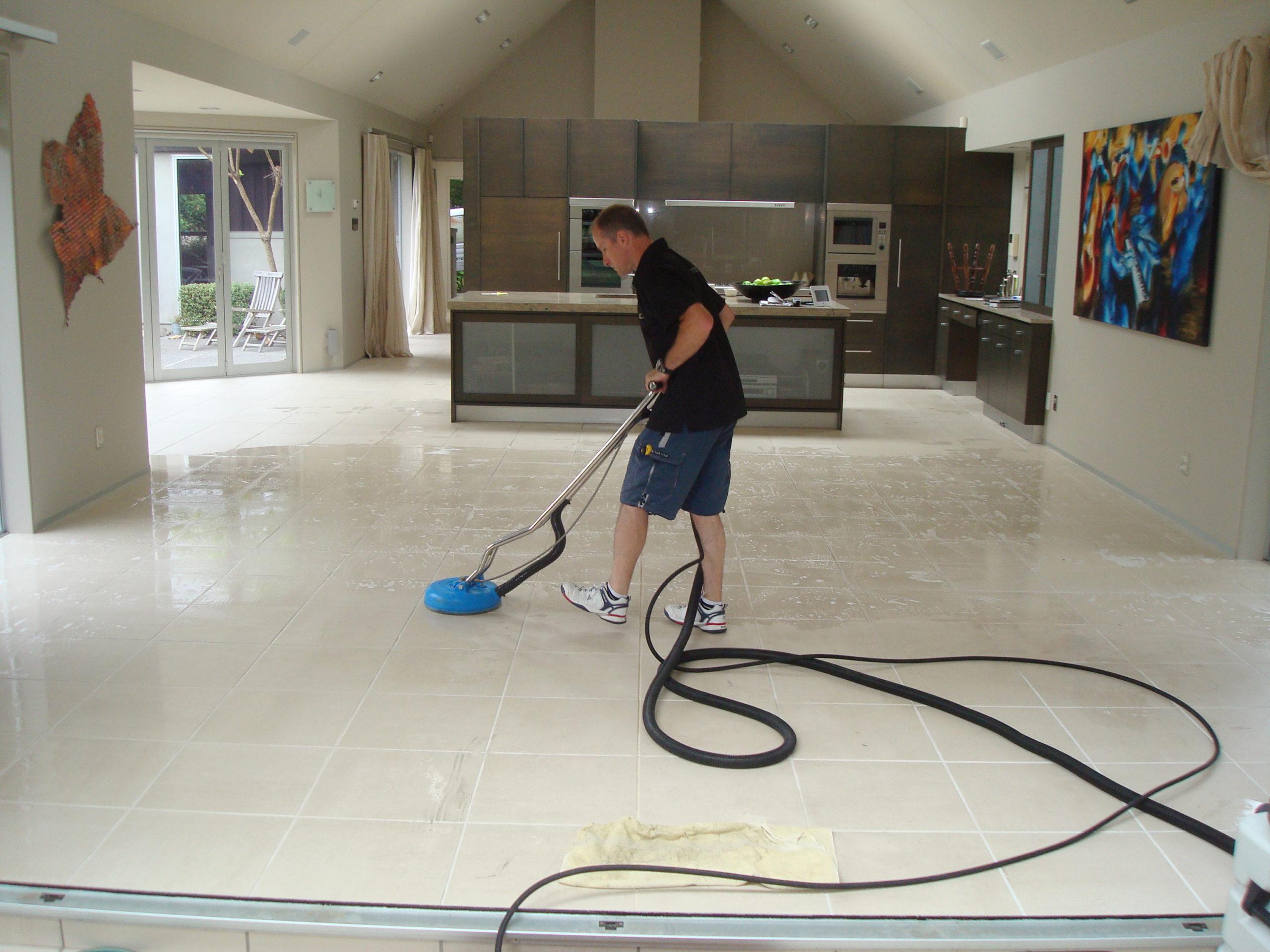 Franchise member cleaning tiles