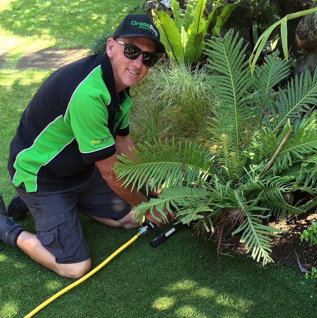Franchise member installing artificial grass